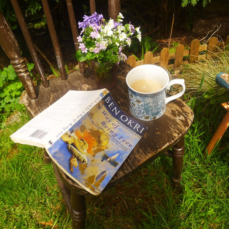 Still life of wildflowers, coffee, and book