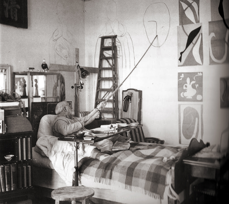 Henri Matisse working from bed