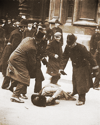 Suffragette beaten by police