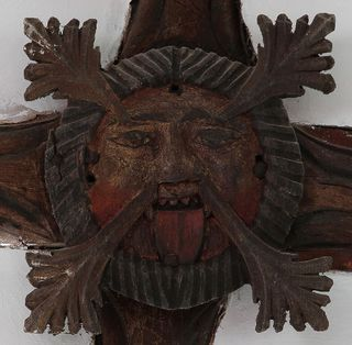 A Green Man carving in a church at King's Nympton, Devon