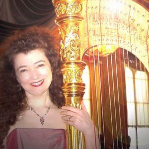 EJ Baldry with her harp, Lancelot