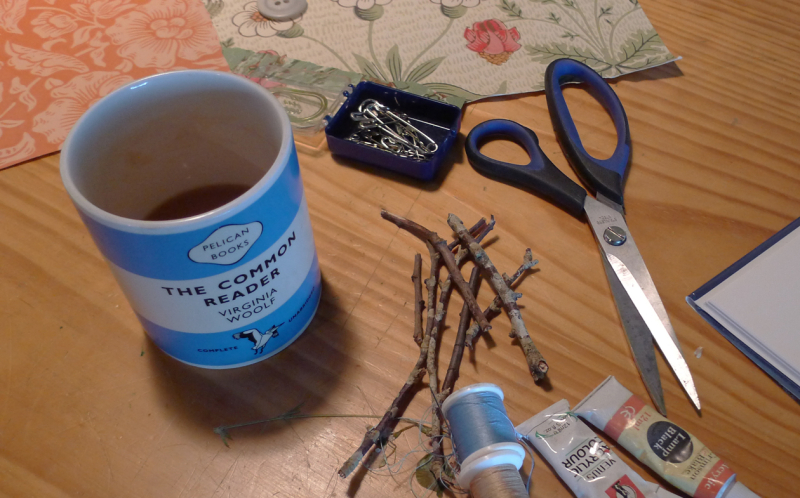 Coffee cup, threads, twigs, paints