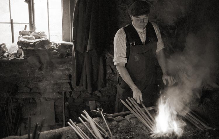 A Devon blacksmith photographed by James Ravilious