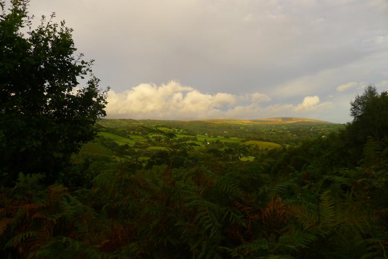 Sun breaks over the fields and moor