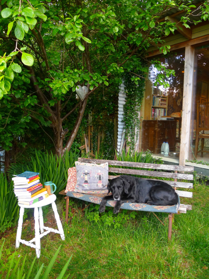 On the bench outside the studio