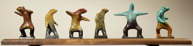 A shelf of small bear shaman sculptures by Gene & Rebecca Tobey